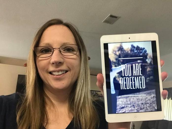 Me holding You Are Redeemed ebook